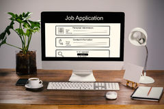 Composite image of digitally generated image of job application. Digitally generated image of Job Application  against computer with personal organizer and Stock Photography