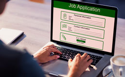 Composite image of digitally generated image of job application. Digitally generated image of Job Application  against cropped image of man working on laptop Stock Image