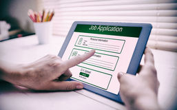Composite image of digitally generated image of job application. Digitally generated image of Job Application  against cropped image of person using on digital Royalty Free Stock Photos