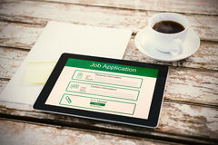 Composite image of digitally generated image of job application. Digitally generated image of Job Application  against overhead of tablet on desk Royalty Free Stock Photos