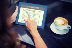 Composite image of digitally generated image of job application. Digitally generated image of Job Application  against woman having coffee and using her tablet Royalty Free Stock Photography