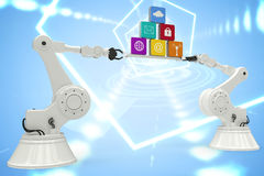 Composite image of digitally generated image of metallic robotic hands holding computer icons Royalty Free Stock Photo