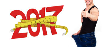 Composite image of digitally generated image of new year with tape measure Stock Photo