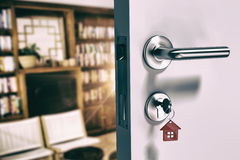 Composite image of digitally generated image of open door with house key Royalty Free Stock Photos