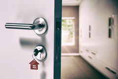 Composite image of digitally generated image of open door with house key Royalty Free Stock Photo