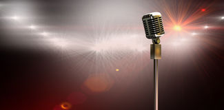 Composite image of digitally generated retro microphone on stand. Digitally generated retro microphone on stand against spotlights royalty free stock photography