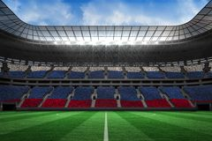 Composite image of digitally generated russian national flag. Digitally generated russian national flag against large football stadium with white fans stock illustration