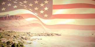 Composite image of digitally generated united states national flag. Digitally generated united states national flag against view of beautiful coastline Stock Images