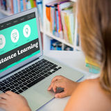 Composite image of distance learning interface. Distance learning interface against girl using laptop in school library Stock Image