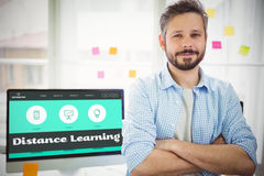Composite image of distance learning interface. Distance learning interface against portrait of businessman sitting in creative office Royalty Free Stock Photography