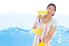 Composite image of distressed woman holding cleaning tools Royalty Free Stock Images