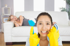 Composite image of distressed woman holding cloth and scrubbing brush Stock Photos