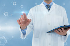 Composite image of doctor holding clipboard while touching transparent interface 3d Royalty Free Stock Photos