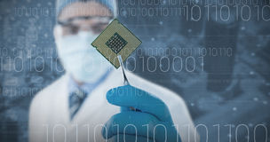 Composite image of doctor holding electronic chip with forceps. Doctor holding electronic chip with forceps against electronic circuit board with processor Royalty Free Stock Photo
