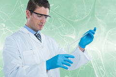 Composite image of doctor in medical gloves filling the test tube 3d Royalty Free Stock Image