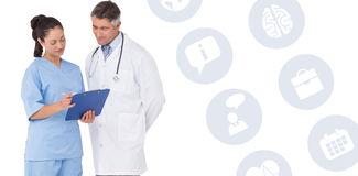 Composite image of doctor and nurse looking at clipboard Stock Photography