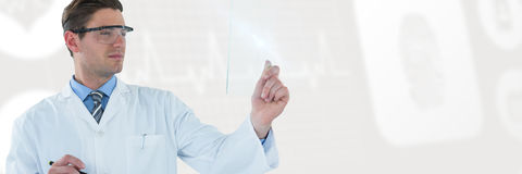 Composite image of doctor pretending to be using futuristic digital tablet Stock Photography
