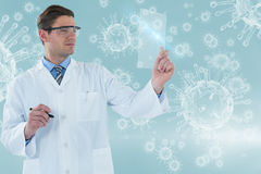 Composite image of doctor pretending to be using futuristic digital tablet 3d Royalty Free Stock Image