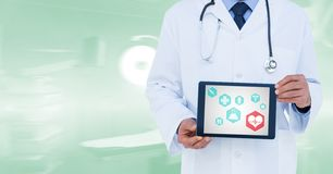 Composite image of doctor showing tablet Stock Photography