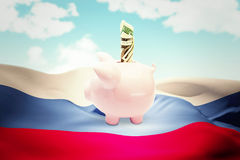 Composite image of dollar in piggy bank Royalty Free Stock Images