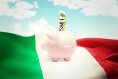 Composite image of dollar in piggy bank Royalty Free Stock Image