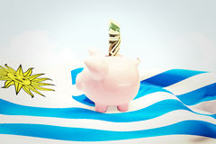 Composite image of dollar in piggy bank Stock Image