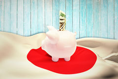 Composite image of dollar in piggy bank Stock Photo