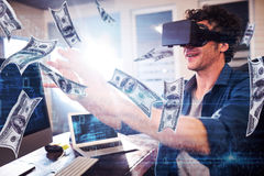 Composite image of dollars flying. Dollars flying against businessman wearing virtual glasses Stock Photo