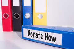 Composite image of donate now Stock Photography