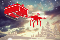 Composite image of drone pulling chirstmas sledge Royalty Free Stock Photos
