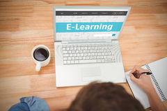 Composite image of e-learning interface. E-learning interface against hipster writing on spiral notebook by laptop at desk in office Stock Images