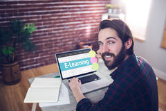 Composite image of e-learning interface. E-learning interface against portrait of smiling editor using laptop Royalty Free Stock Photo