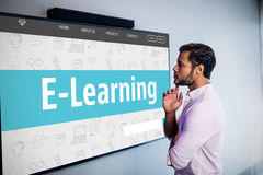 Composite image of e-learning interface. E-learning interface against thoughtful man looking over whiteboard Stock Photo
