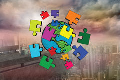 Composite image of earth and jigsaw pieces doodle Stock Photo