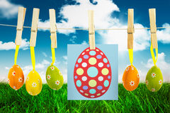 Composite image of easter egg. Easter egg against field and sky Stock Image
