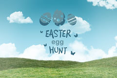 Composite image of easter egg hunt graphic. Easter egg hunt graphic against field and sky Royalty Free Stock Photos