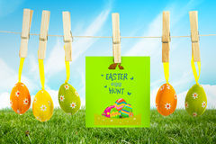 Composite image of easter egg hunt graphic. Easter egg hunt graphic against field and sky Stock Photography