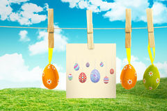 Composite image of easter eggs. Easter eggs against field and sky Stock Images