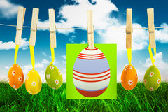 Composite image of easter eggs. Easter eggs against field and sky Royalty Free Stock Image