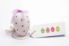 A Composite image of easter eggs. Easter eggs against white easter egg with blank tag Royalty Free Stock Photos