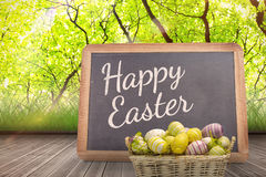 A Composite image of easter eggs in basket royalty free stock images