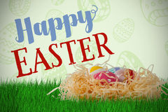 Composite image of easter eggs in creative paper nest Stock Photography