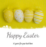 Composite image of easter eggs on grass outline Stock Photos