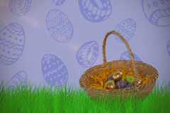 Composite image of easter eggs in paper nest basket Royalty Free Stock Photos