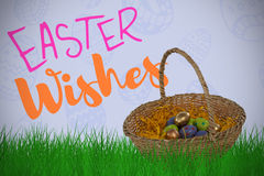 Composite image of easter eggs in paper nest basket Royalty Free Stock Image