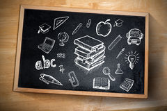 Composite image of education doodles. Against chalkboard Royalty Free Stock Photography