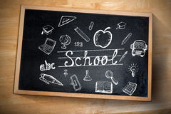 Composite image of education doodles. Against chalkboard Stock Photos