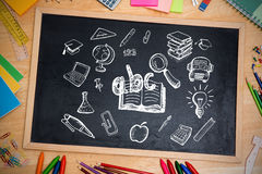 Composite image of education doodles. Against chalkboard Royalty Free Stock Photos