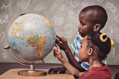 Composite image of education doodles. Education doodles against kids pointing at globe in classroom Stock Photos
