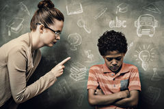 Composite image of education doodles. Education doodles against teacher shouting at boy in classroom Stock Photography